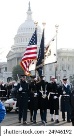 WASHINGTON, DC - JAN 20: A color guard representing all branches of the U.S. Armed Forces march past the U.S. Capitol as part of the 2009 inaugural parade of President Barack Obama.