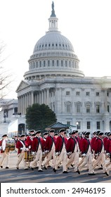 WASHINGTON, DC - JAN 20: A formation of marchers in colonial garb march past the U.S. Capitol as part of the 2009 inaugural parade of President Barack Obama.