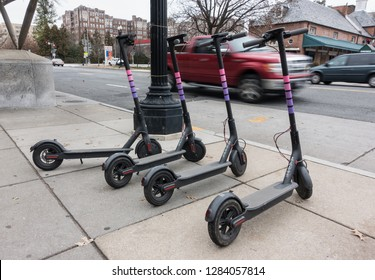 WASHINGTON, DC - JAN. 2019: Lyft dockless electric scooters. Lyft is one of several  companies that have introduced dockless electric scooters in DC.