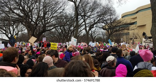 WASHINGTON DC - JAN 21, 2017: Women's March on Washington, marchers in front of the National Museum of the American Indian, part of the large turnout in the anti-inauguration show of solidarity.