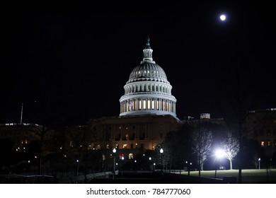Washington, D.C. - January 1, 2018: A supermoon rises behind the U.S. Capitol building on the first day of the new year.