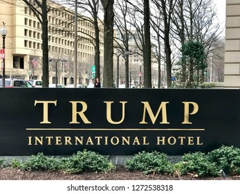 WASHINGTON, DC - JANUARY 1, 2019: TRUMP INTERNATIONAL HOTEL sign at hotel entrance. Trump Hotel is located in the Old Post Office building, which was leased by the federal government to Trump Hotel.