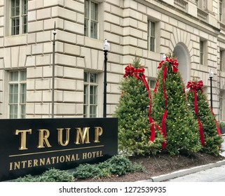 WASHINGTON, DC - JANUARY 1, 2019: TRUMP INTERNATIONAL HOTEL sign at hotel entrance with Christmas tree decorations. Trump Hotel is located in the Old Post Office building.