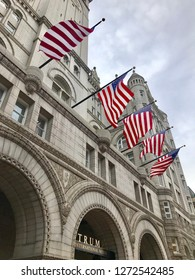 WASHINGTON, DC - JANUARY 1, 2019: TRUMP INTERNATIONAL HOTEL sign at hotel exterior with American Flags. Trump Hotel is located in the Old Post Office building, a national historic site.