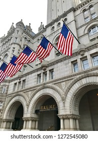WASHINGTON, DC - JANUARY 1, 2019: TRUMP INTERNATIONAL HOTEL exterior sign building facade with American Flags. Trump Hotel is located in the Old Post Office building, a national historic site.