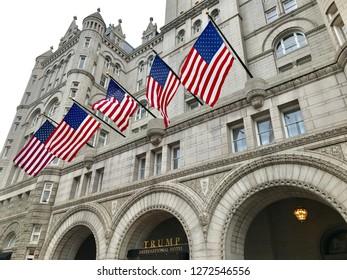 WASHINGTON, DC - JANUARY 1, 2019: TRUMP INTERNATIONAL HOTEL - Old Post Office Building - American Flags. Trump Hotel is located in the Old Post Office building, a national historic site.