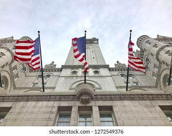 WASHINGTON, DC - JANUARY 1, 2019: TRUMP INTERNATIONAL HOTEL exterior building facade with American Flags. Trump Hotel is located in the Old Post Office building, a national historic site.