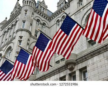WASHINGTON, DC - JANUARY 1, 2019: FLAGS AMERICAN USA  - TRUMP INTERNATIONAL HOTEL building facade. Trump Hotel is located in the Old Post Office building, a national historic site.