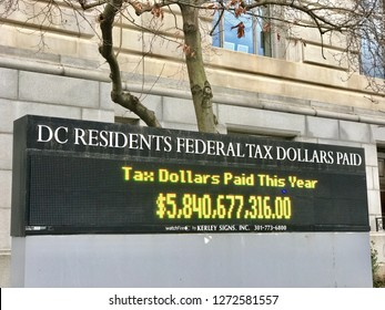 WASHINGTON, DC - JANUARY 1, 2019: Taxation without representation - DC GOVERNMENT Sign supports DC Statehood.