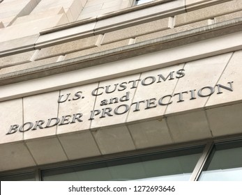 WASHINGTON, DC - JANUARY 1, 2019: US CUSTOMS AND BORDER PROTECTION CBP sign close up at agency headquarters office building entrance.
