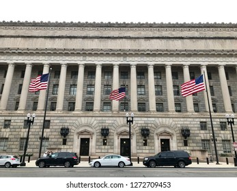 WASHINGTON, DC - JANUARY 1, 2019: COMMERCE DEPARTMENT headquarters building facade with flags.