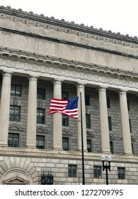 WASHINGTON, DC - JANUARY 1, 2019: US DEPARTMENT OF COMMERCE headquarters building exterior with American flag.