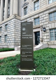 WASHINGTON, DC - JANUARY 1, 2019: US DEPARTMENT OF COMMERCE headquarters building with sign at entrance.