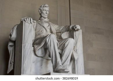 Washington DC  ?? January 10, 2016: The statue of President Lincoln greets visitors to the memorial perched at the end of the reflecting pool on the National Mall