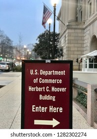 WASHINGTON, DC - JANUARY 12, 2019: DEPARTMENT OF COMMERCE sign points to headquarters building entrance.