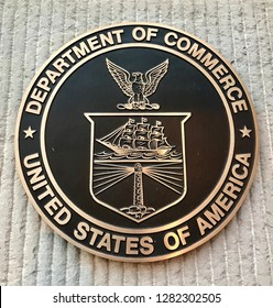WASHINGTON, DC - JANUARY 12, 2019: DEPARTMENT OF COMMERCE sign seal emblem at headquarters building.