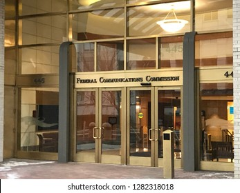 WASHINGTON, DC - JANUARY 12, 2019: FCC - FEDERAL COMMUNICATIONS COMMISSION headquarters building entrance with sign.