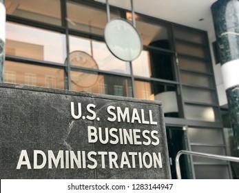 WASHINGTON, DC - JANUARY 12, 2019: SBA - SMALL BUSINESS ADMINISTRATION sign emblem seal at headquarters building entrance.