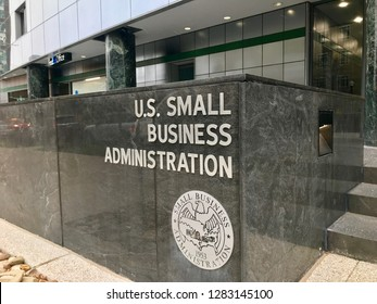 WASHINGTON, DC - JANUARY 12, 2019: SBA - SMALL BUSINESS ADMINISTRATION sign emblem seal at headquarters building entrance.