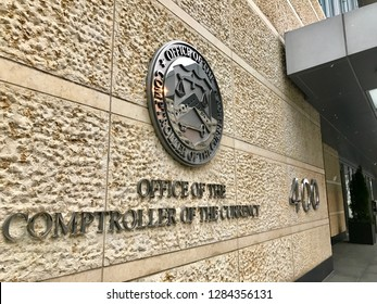 WASHINGTON, DC -  JANUARY 12, 2019: COMPTROLLER OF THR CURRENCY headquarters building entrance with sign seal emblem.