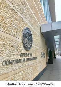 WASHINGTON, DC -  JANUARY 12, 2019: COMPTROLLER OF THE CURRENCY headquarters building entrance with sign seal emblem.