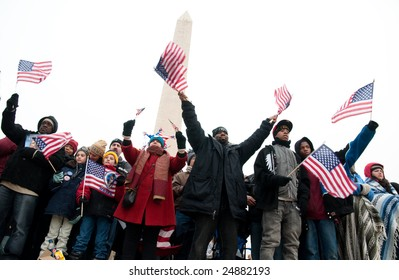 WASHINGTON, DC - JANUARY 18, 2009: Crowds of flag-waving supporters fill the National Mall to celebrate the 2009 inauguration of Barack Obama, America's first African American president.