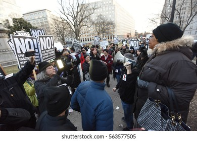 WASHINGTON DC - JANUARY 19 2017: Pro & anti Trump forces gather in the nation's capital for the next day's inauguration. Stop Fascism protestors gather & march against inauguration