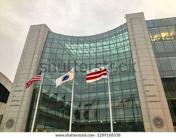 WASHINGTON, DC - JANUARY 19, 2019: SEC - SECURITIES AND EXCHANGE COMMISSION- sign at entrance to DC headquarters building with flags.