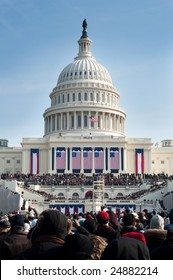 WASHINGTON, DC - JANUARY 20, 2009: A crowd of warmly dressed onlookers attends the 2009 inauguration of President Barack Obama, America's first African American president.