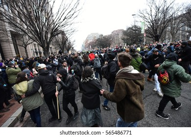 WASHINGTON DC - JANUARY 20 2017: Protests filled Washington DC during Donald Trump's Inauguration Day. Protestors run in the streets