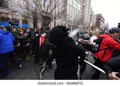 WASHINGTON DC - JANUARY 20 2017: Protests filled Washington DC during Donald Trump's Inauguration Day. DC Police pepper spray protestors