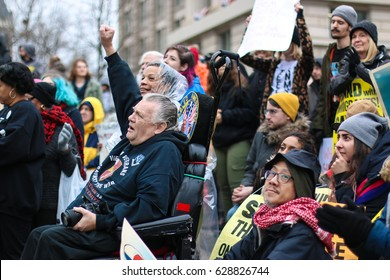 Washington, DC - January 20, 2017: On Inauguration Day, protesters fill the streets to voice their opposition to the election of President Donald Trump.