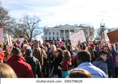 Washington, DC - January 20, 2018: Nearly a year after the historic Women's March on Washington, activists gather in Lafayette Park outside of the White House to make their voices heard.