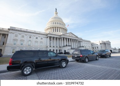 WASHINGTON, DC - JANUARY 20, 2018: Black SUVs parked in front of the United States Capitol on the first day of the government shutdown.