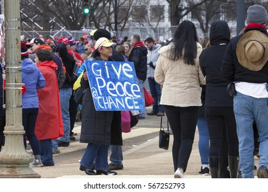 WASHINGTON, DC - JANUARY 20:  Woman carries peace sgn during inauguration of Donald Trump.  Taken January 20, 2017 in District of Columbia.