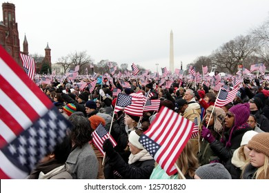 WASHINGTON, D.C. - JANUARY 21: Crowd waving flags at 2013 Inauguration of Barack Obama on January 21, 2013 in Washington, D.C.