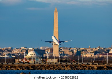 Washington, D.C.- January 22, 2021: Delta Airlines Airbus A321 takes off from Ronald Reagan National Airport with the Washington Monument in the background