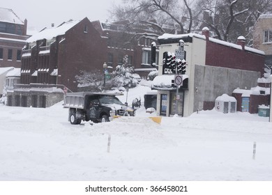Washington, DC - January 23, 2016: Plow clearing the street in Georgetown