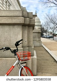 WASHINGTON, DC - JANUARY 26, 2019: MOBIKE - BIKE SHARE - with US Capitol Building in background.