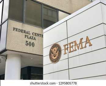 WASHINGTON, DC - JANUARY 26, 2019: FEMA - FEDERAL EMERGENCY MANAGEMENT headquarters building sign emblem seal at building entrance.