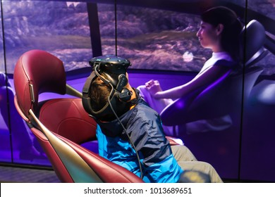 Washington, DC - January 27, 2018: A child tries on a pair of virtual reality glasses to experience a simulation of riding in a futuristic autonomous vehicle.
