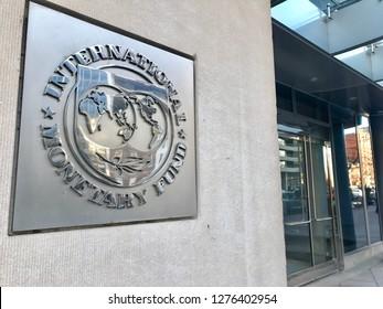 WASHINGTON, DC - JANUARY 6, 2019: IMF - INTERNATIONAL MONETARY FUND - sign emblem at building entrance.