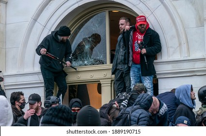 Washington, DC - January 6, 2021: Pro-Trump protesters seen inside Capitol building as they enter in through broken windows