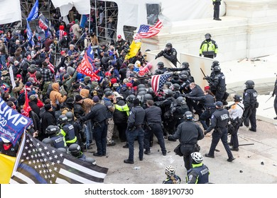 Washington, DC - January 6, 2021: Pro-Trump protesters and police clash on top of the Capitol building