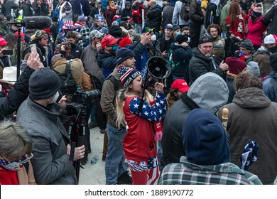 Washington, DC - January 6, 2021: Woman with Infowars megaphone inciting people at Capitol building where pro-Trump supporters riot and breached the Capitol