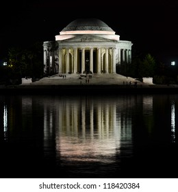 Washington DC, Jefferson Memorial at night with mirror reflection on water,