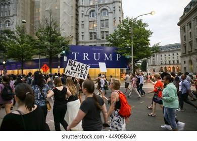 Washington, D.C. - July 07 2016: Protestors march past the Trump Hotel enroute towards the Capitol Building after recent police involved shootings of Alton Sterling and Philando Castile