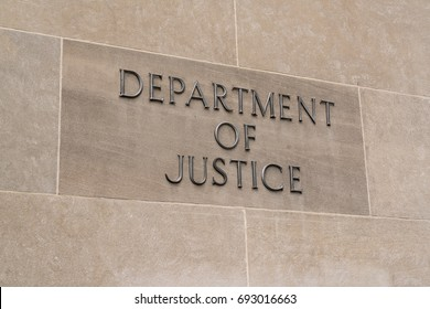 WASHINGTON, DC - JULY 12: United States Department of Justice sign in Washington, DC on July 12, 2017
