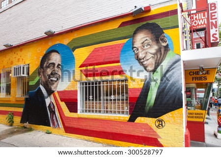 WASHINGTON, DC - JULY  17: Mural depicting President Barack Obama and Bill Cosby at Benâ??s Chili Bowl in Washington, DC on July 17, 2015.