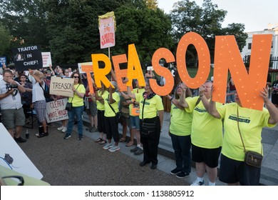 "WASHINGTON, DC - JULY 18, 2018: Demonstrators outside White House protesting President Donald Trumps ""treasonous"" relationship with Russian President Vladimir Putin at early evening protest."